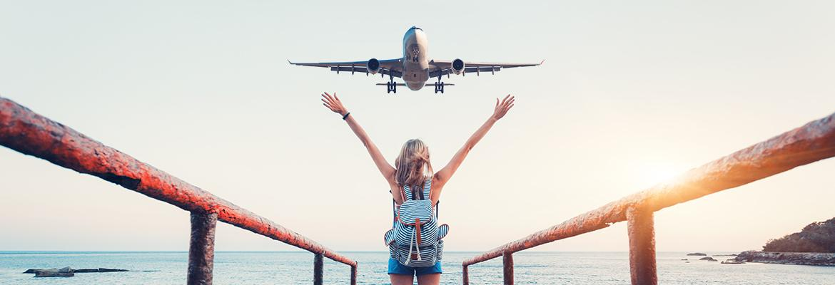 woman waving to an airplane