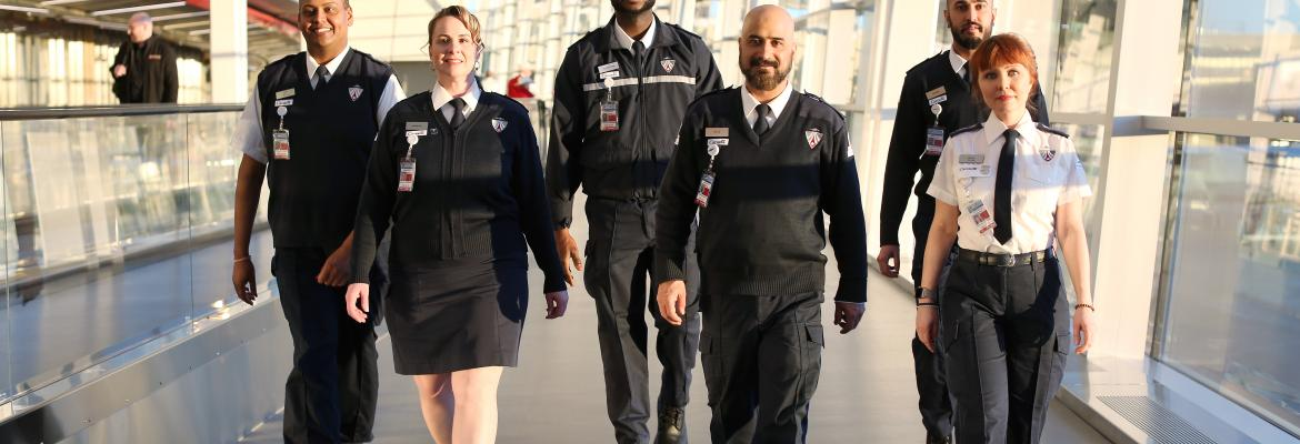 men and women in CATSA uniforms at an airport